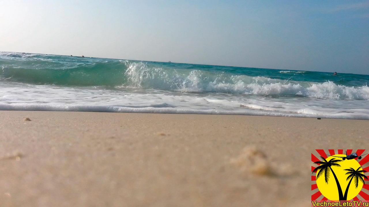 Вода-на-пляже